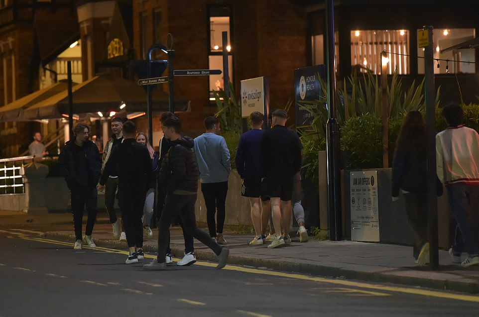 Newcastle students outside a bar in the city centre getting ready to head home as a curfew comes into effect at 10pm