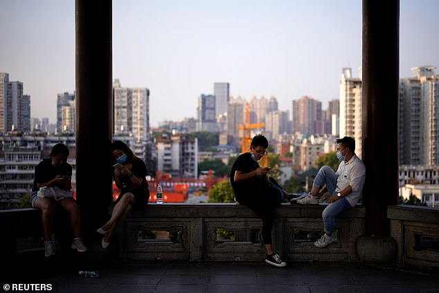 Four members of a family-of-five living on the 15th floor of the apartment in Guangzhou, China, had recently returned home from Wuhan (pictured) - the centre of the outbreak - when two middle aged couples on the 25th and 27th floors started feeling unwell