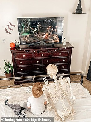 Two-year-old's favorite toy is a five-foot-tall Halloween skeleton