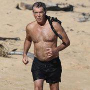 Pierce Brosnan, 67, Looks Super Buff While Running On The Beach Shirtless — Pics