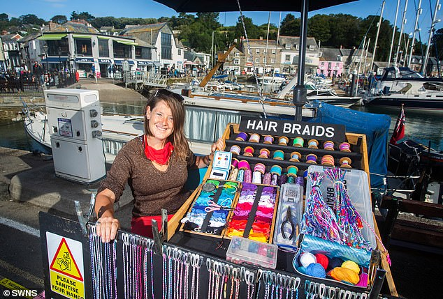 Natasha Rowley, 47, pictured while working at Padstow harbour, said the traders have faced abuse despite 'consistently proving they had done nothing wrong'