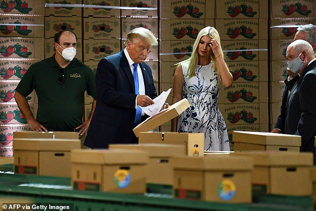 The president is captured holding what looks to be the controversial letter during his tour of Flavor First Growers and Packers in Mills River, North Carolina in late August