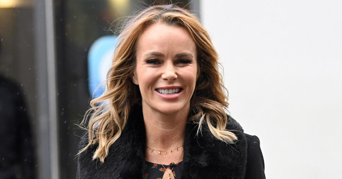 Amanda Holden teases her cleavage in sexy keyhole detail dress
