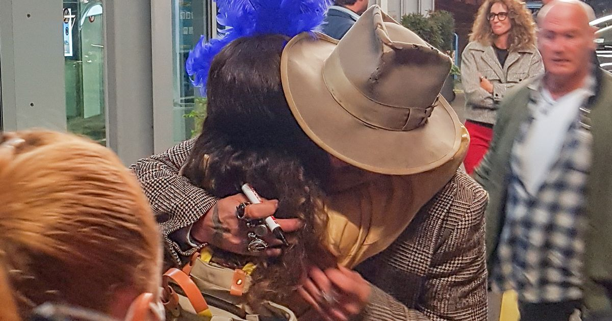 Johnny Depp flouts social distancing rules to hug fan after landing in Zurich
