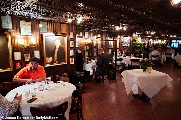 Diners inside Keens Steakhouse on Wednesday on the first day of indoor dining in New York City. Restaurants can operate at a 25 percent capacity