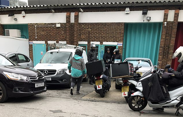 Deliveroo does little to advertise its presence at the Battersea kitchen and the only obvious clue is a group of 30 motorbikes parked outside as the riders wait to collect hot food