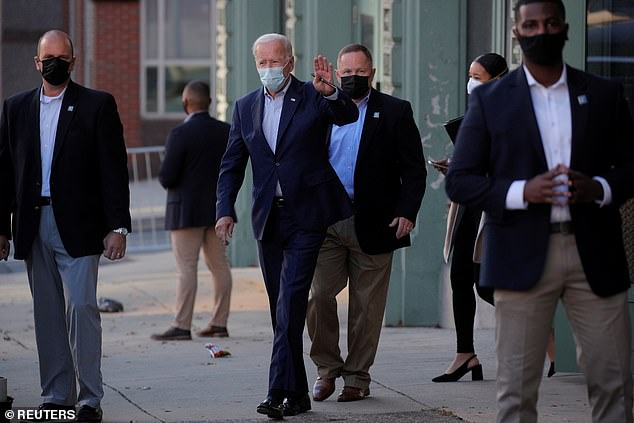 Biden, photographed leaving the church on Saturday, has been mocked for wearing a mask