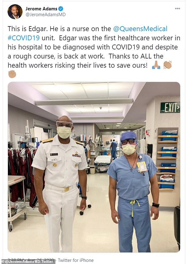Adams, 46, the nation's top public health spokesperson, traveled to Hawaii in August to assist state officials with their response to the COVID-19 outbreak. He is pictured above with a local healthcare worker