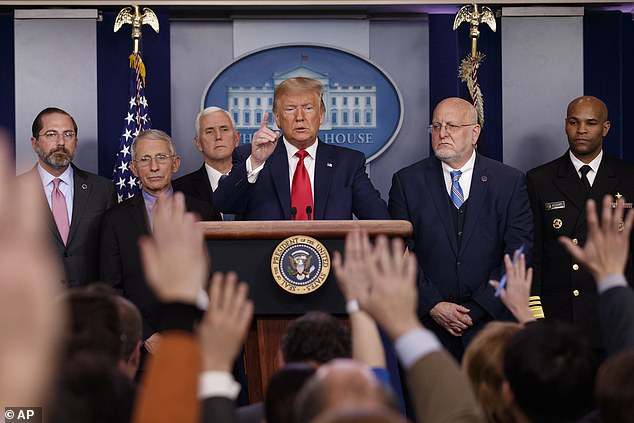 Adams (far right) is pictured during a coronavirus press briefing at the White House at the beginning of the pandemic on February 29