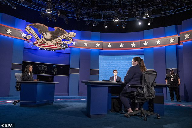 The debate hall at the University of Utah is being set up for Wednesday's vice presidential debate, but the campaigns were still bickering over whether there will be plexiglass set up between the two candidates through Tuesday evening