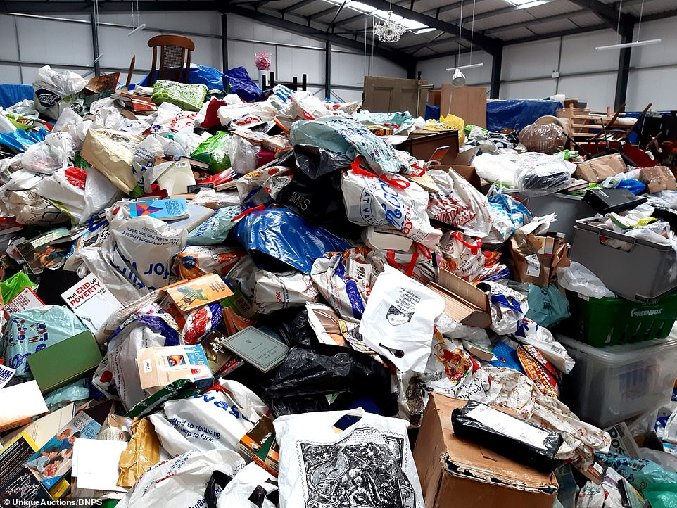 The horde mostly consisted of unopened parcels that had been delivered to the three-bedroom property in Nottingham since 2002 where a bachelor, who died suddenly earlier this year at the age of 44, lived alone