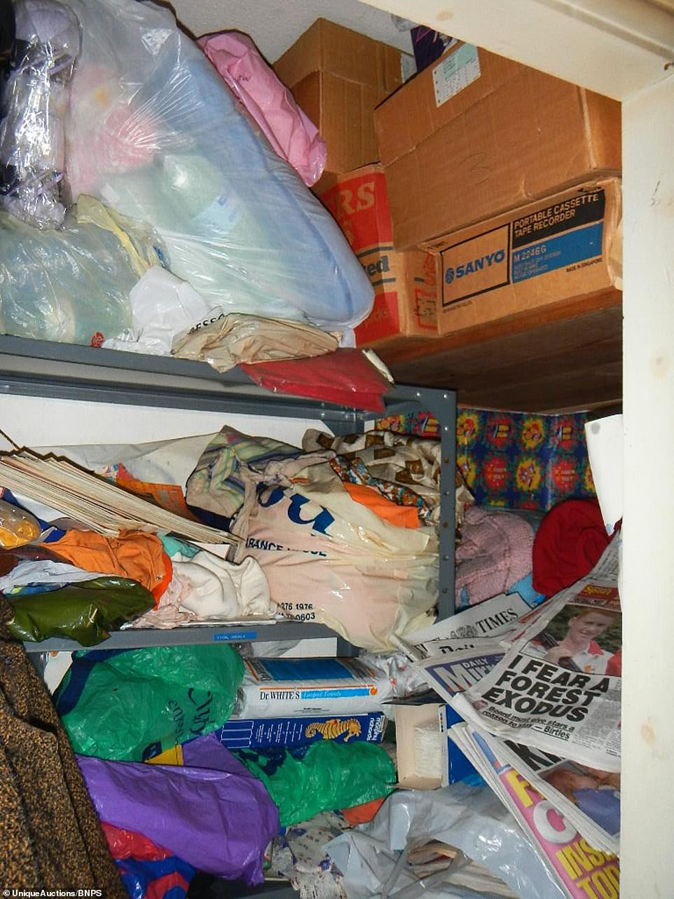Items stuffed into a cupboard. The auctioneerscouldn't get in through the front door so were forced to go around the back