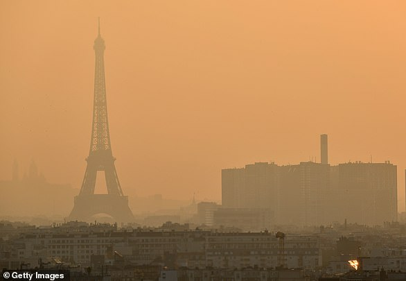 The Paris Agreement, which was first signed in 2015, is an international agreement to control and limit climate change. Pictured: air pollution over Paris in 2019.