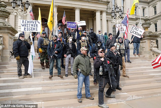 Whitmer was widely condemned in Michigan for enforcing a lockdown to stop the spread of COVID-19. Above, protesters on April 15 storming the state capitol with guns