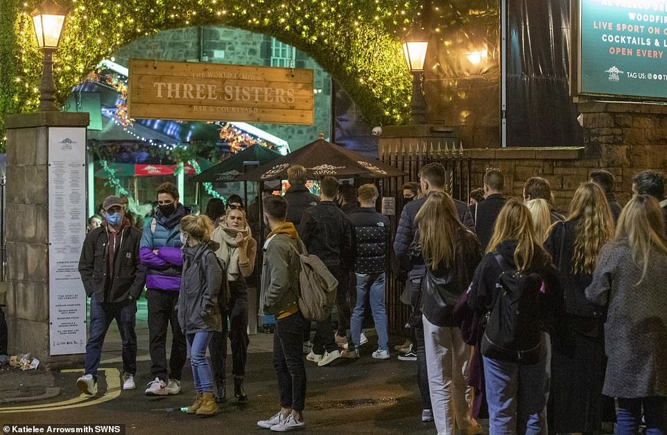 The lure of one final drink saw huge queues at some venues for people trying to have their last night out before the ban (pictured, Edinburgh)