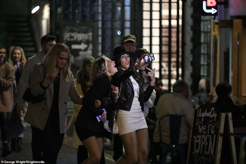 Some revellers took selfies of their last night of drinking before the strict regulations came in for parts of Scotland (pictured, Glasgow)