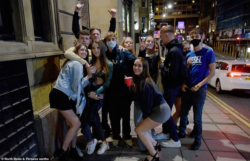 Sir Keir Starmer accused Boris Johnson of causing 'confusion, chaos and unfairness' by revealing the exact measures will be announced next week, while they are still being discussed. Pictured: revellers in Newcastle