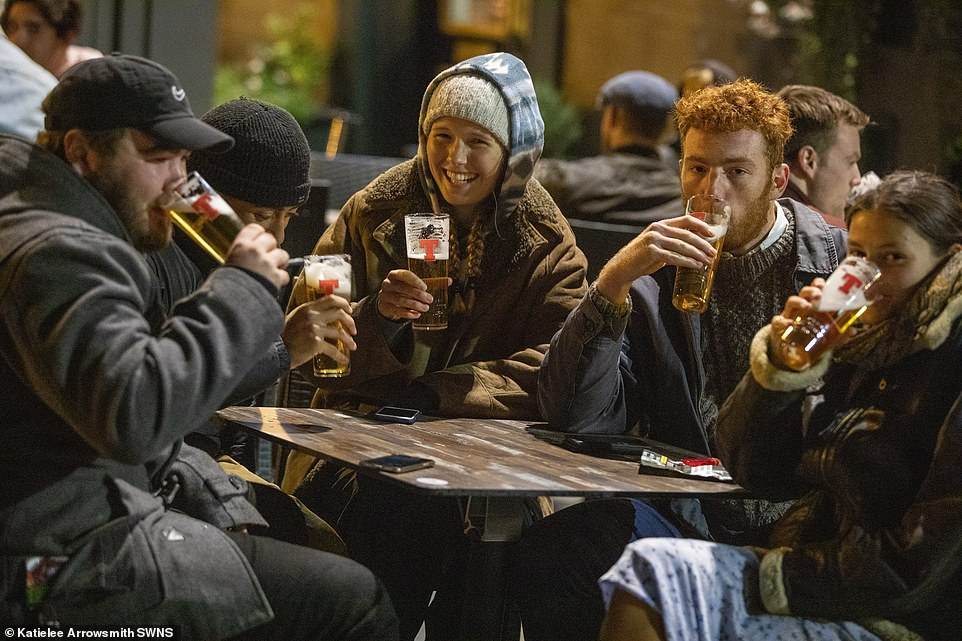 Drinkers in Edinburgh share a final sup as they marked the final night before the coronavirus tackling rules were imposed