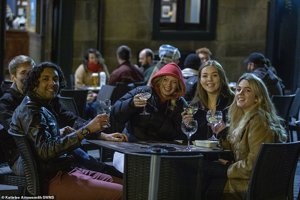 Five Edinburgh drinkers raise their glasses for a final time before the hospitality sector is hit tonight by the new rukes