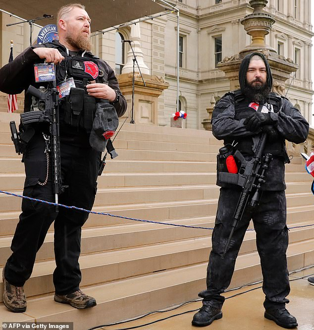 Michael Null (left) and William Null (right) at a protest outside the Michigan State Capitol in Lansing in April. Null later defended a Confederate statue