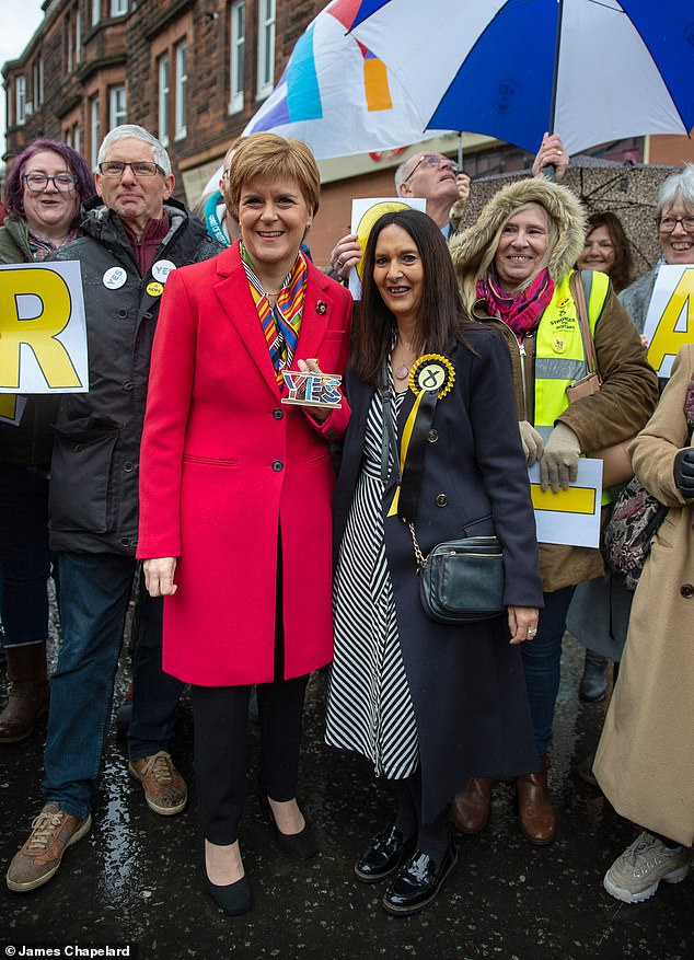 Ms Ferrier, 60, (pictured with Scottish First Minister Nicola Sturgeon) is yet to resign from the Commons despite being stripped of the SNP whip amid calls for her to quit for putting people's lives at risk