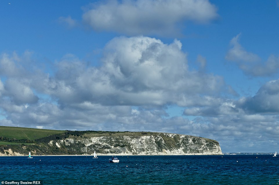 Much of the UK has a dry day with sunny periods today but it remains chilly with wet weather moving eastwards (Swanage, Dorset, pictured)