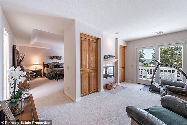 Master bedroom: Josh's two-story home was built in 1989 and it features three bathrooms and four bedrooms - one of which has a private balcony, sitting room, and fireplace