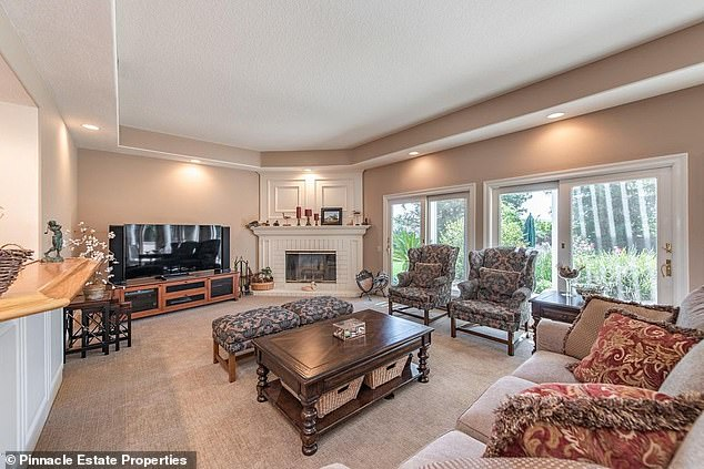 Take a seat! Josh's family room has sliding doors leading to the backyard as well as a wet bar and a whitewashed brick corner fireplace