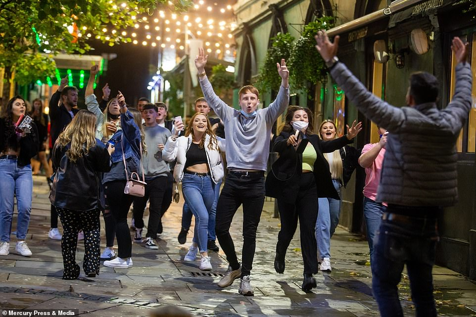 Revellers leave the pubs after closing time in Liverpool city centre after enjoying the last weekend before COVID restrictions are expected to force pubs and bars close in the area