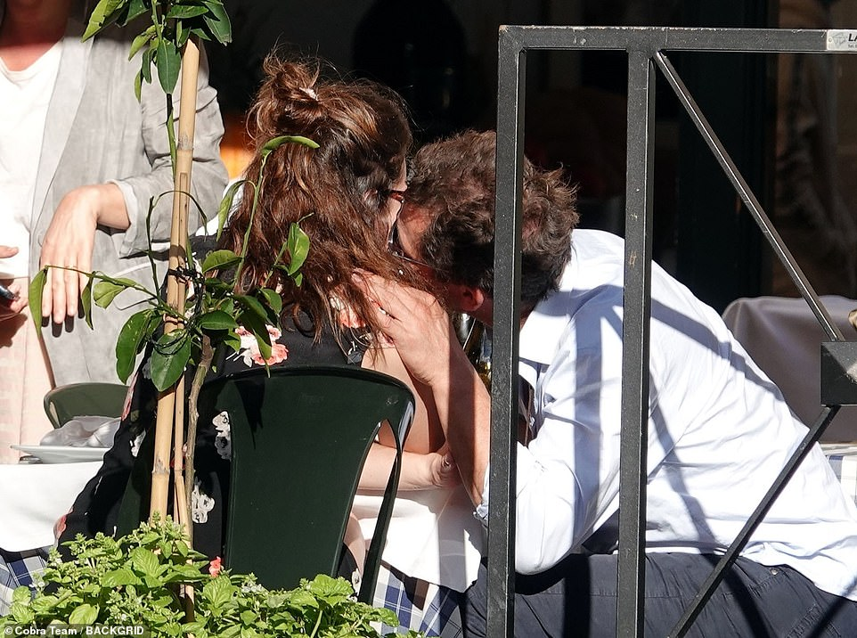 PICTURE EXCLUSIVE: Dominic West's wife Catherine FitzGerald is 'shocked, heartbroken and devastated' after pictures emerged of him in a passionate embrace with Lily James taken in Rome on Sunday (pictured)
