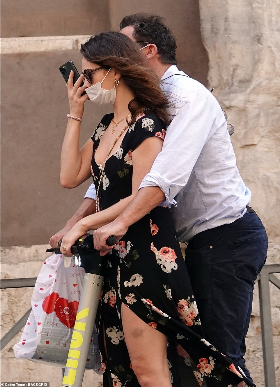 Cosy:The actor, 50, and the Mamma Mia! star, 31, didn't seem to mind who saw them as they cuddled up to one another and shared a ride on an electric scooter while taking in the sights, tenderly touching throughout the day