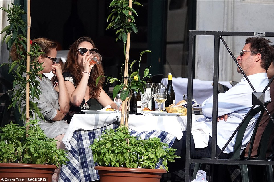 Bottoms up! Lily was seen knocking back her glass of wine during lunch