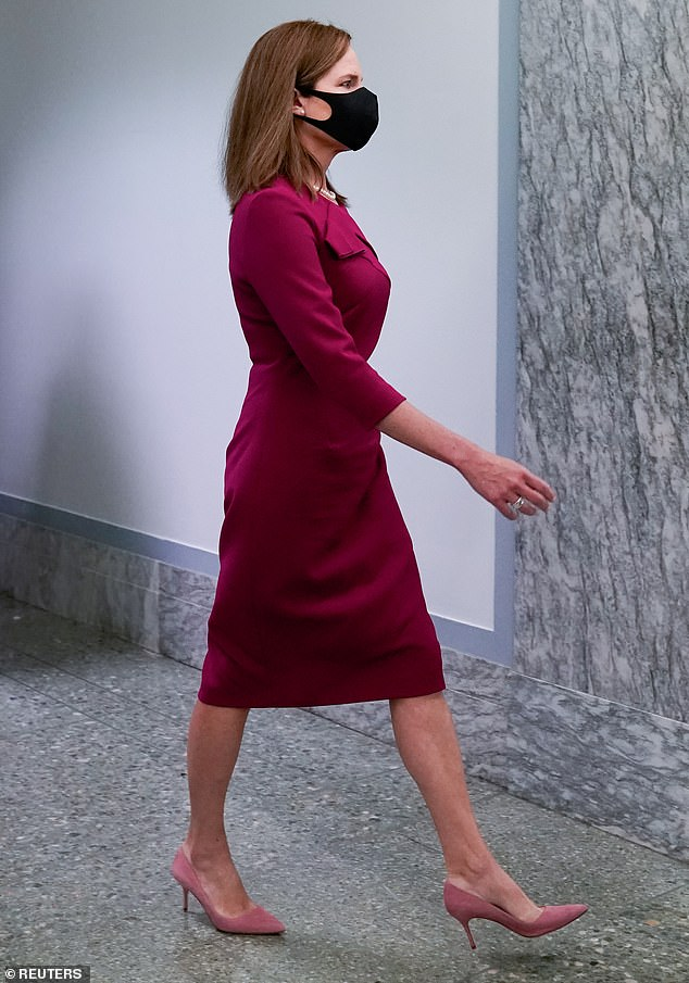 Demure: While the $425 dress that the nominee wore on day one was more figure hugging, it had a lower hemline than her day two look - an example of the 'balance' that Barrett aimed for