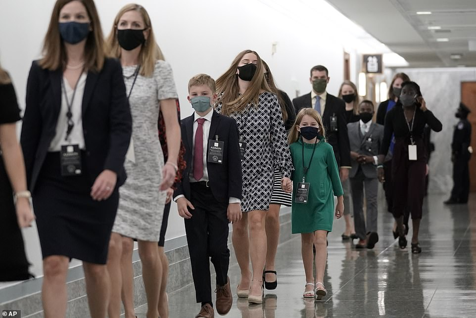 Family arrival: Six of Amy Coney Barrett's children arrived just ahead of her for the hearing