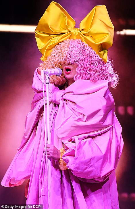 Curl power! Next, Sia performed Courage To Change on stage wearing an elaborate yellow bow on her hair