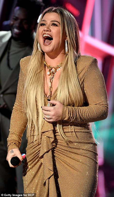 Golden girl: The American Idol vet looked fab in a ruched gold dress as she kicked off the big show