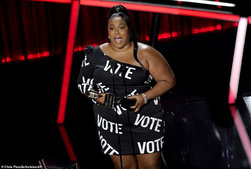Making a statement: Lizzo urged viewers to head to the polls with her statement dress as she accepted the award for Top Song Sales Artist