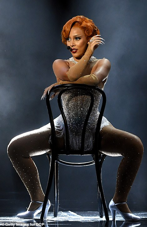 Well heeled: Doja worked silver heels as she danced about on stage