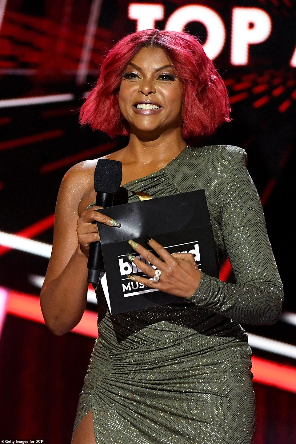Hello beautiful! Taraji P. Henson worked a glittering number as she presented the award for Top Artist