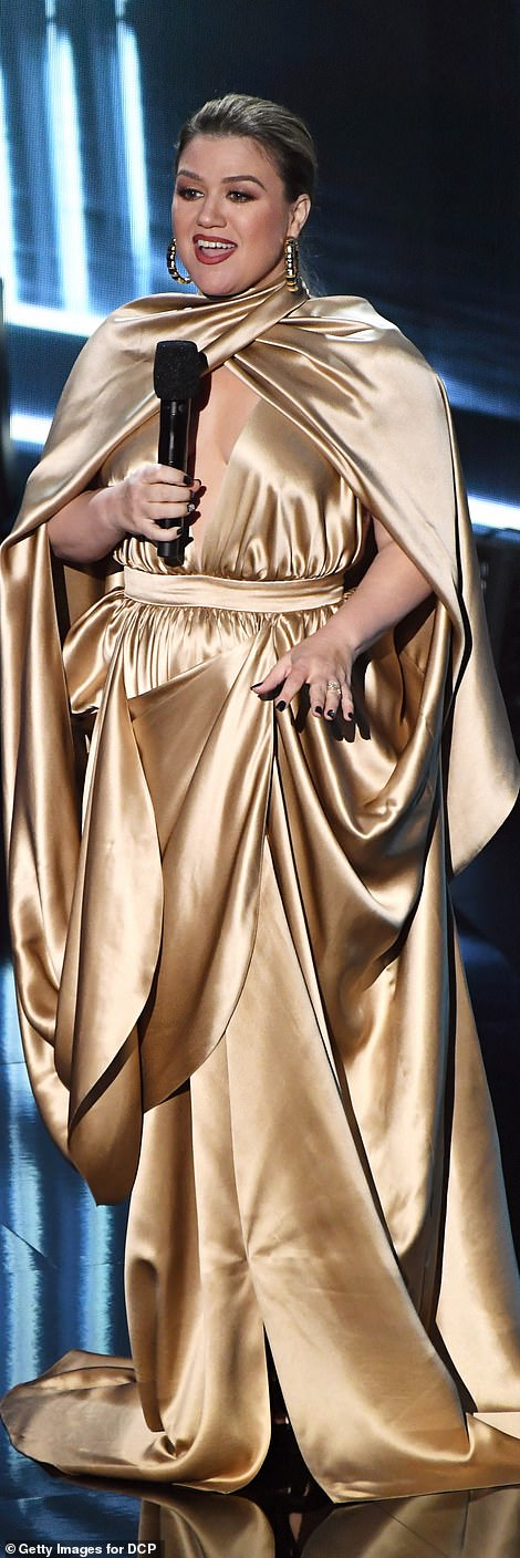The many looks of Kelly! Clarkson worked an array of ensembles, including a silky gold gown and embellished black number