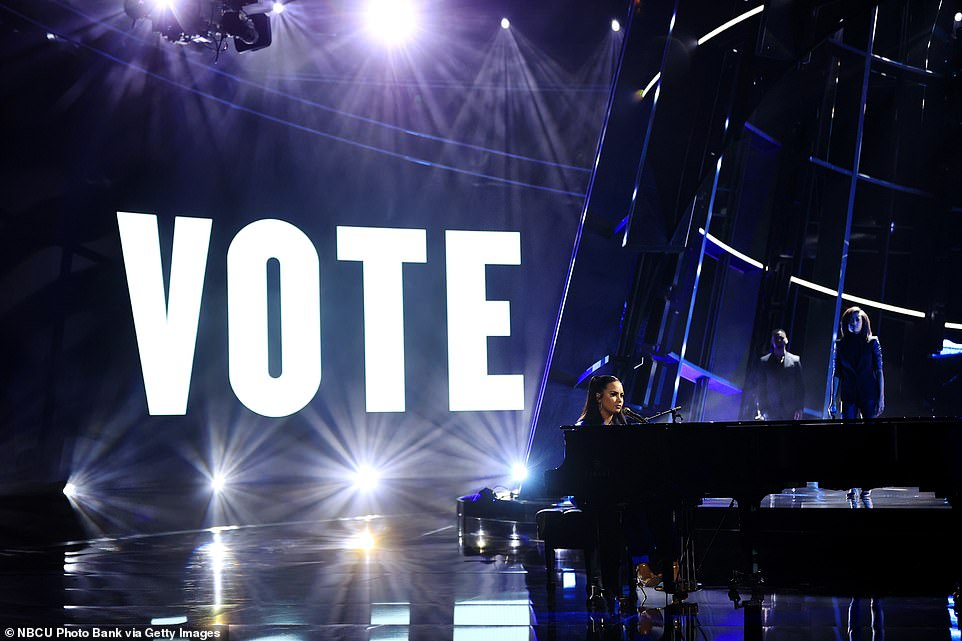 Head to the polls! The word 'Vote' appeared boldly behind her throughout the performance