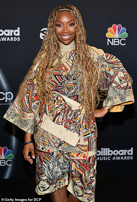 Avant-garde: Brandy, 41, went avant-garde in a beige turtleneck, featuring a multi-colored abstract print, paired with matching shorts