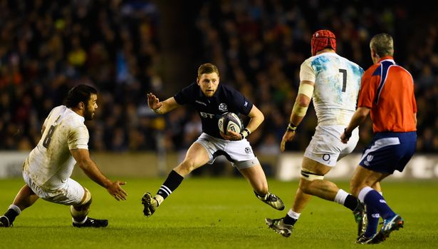 Finn Russell of Scotland is closed down by Billy Vunipola and James Haskell of England