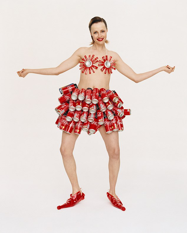 Edie Campbell wears an outfit made out of Coke cans for a fashion shoot for More Or Less magazine