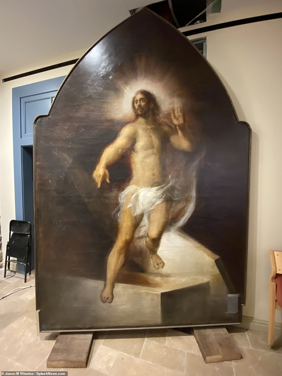 Pictured: a portrait of Jesus Christ was photographed insideThe Basilica of St. Patrick's Old Cathedral, where a family vault was put on sale
