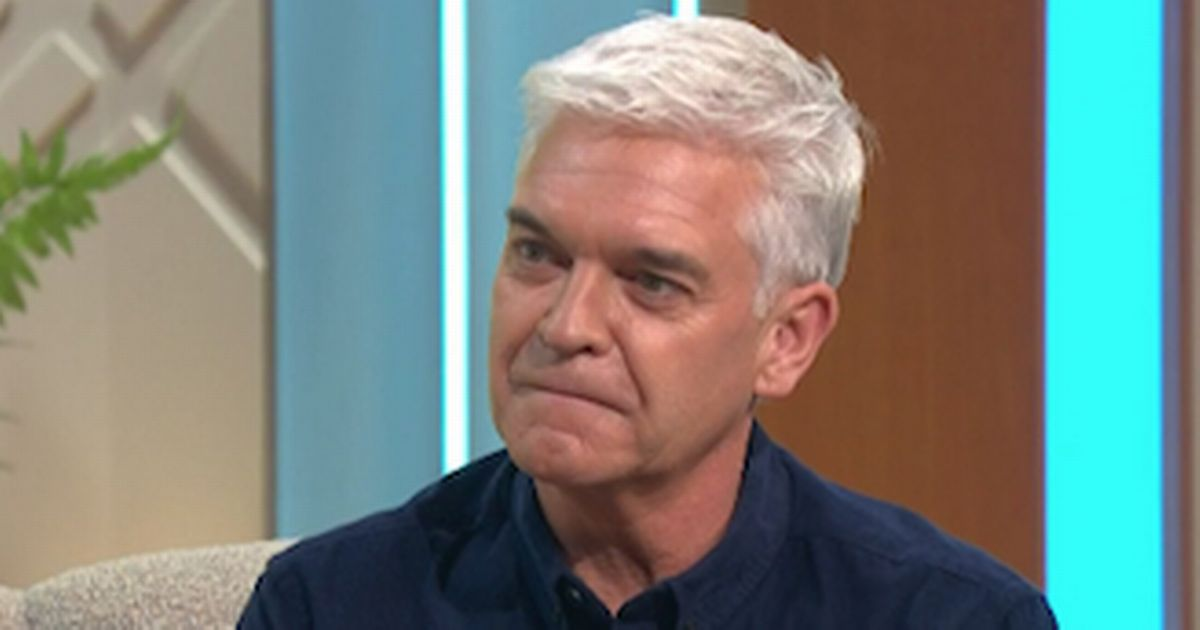 Phillip Schofield smokes cigarette on night out after bombshell feud claims