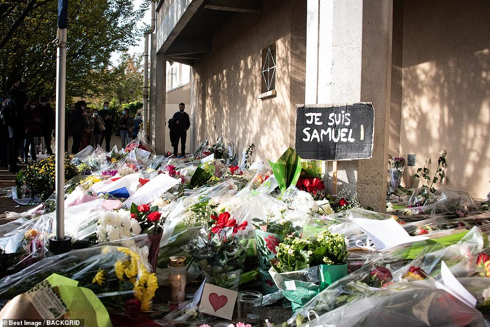 Some placed placards outside Paty's school in Conflans-Sainte-Honorine reading 'I am Samuel' that echoed the 'I am Charlie' rallying cry after the 2015 attack on the satirical newspaper Charlie Hebdo, which published caricatures of Mohammed
