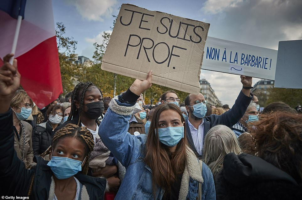 Demonstrators have gathered in several French cities to support freedom of speech after history teacher Samuel Paty was brutally murdered by an Islamic extremist for showing his class caricatures of the Prophet Mohammed. Pictured: Several people held signs reading 'Je suis Prof, Je suis Samuel' (meaning 'I am a teacher, I am Samuel) to echothe 'I am Charlie' rallying cry after the 2015 attack on satirical newspaper Charlie Hebdo