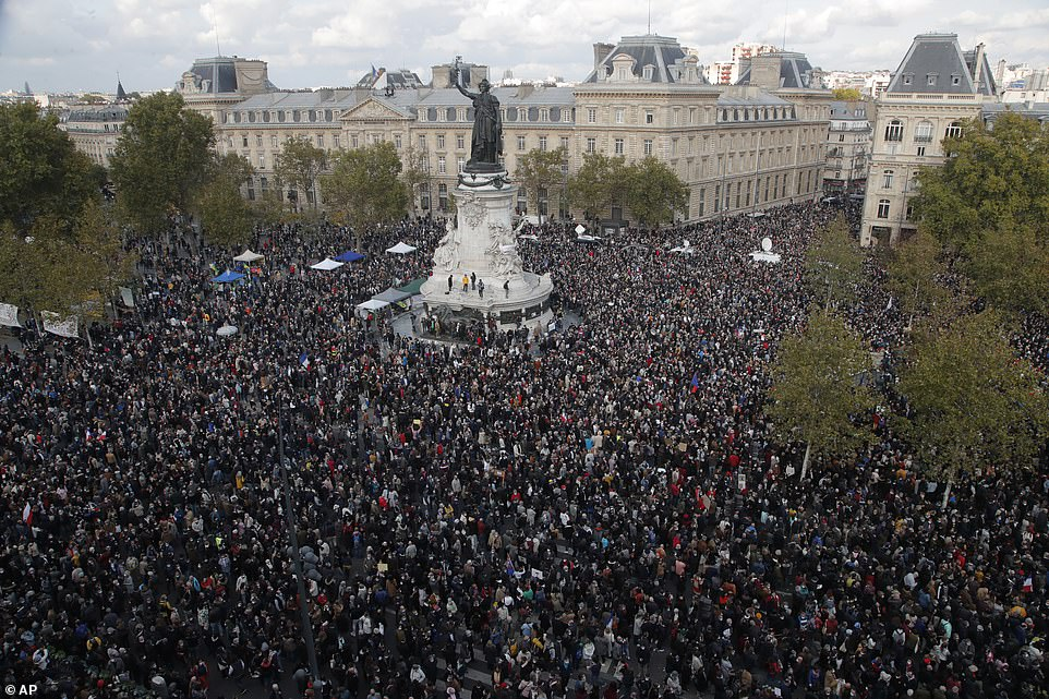 Thousands gathered in Place de la Reublique to pay tribute to a history teacher who was brutally murdered by an Islamic extremist for showing cartoons of the Prophet Mohammed to his class