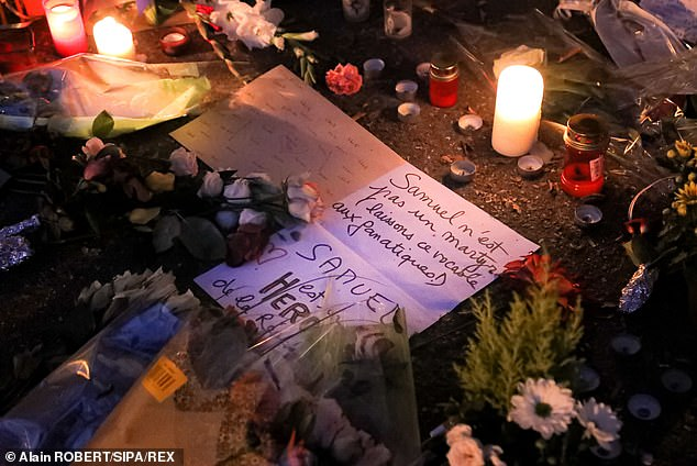 Candles, flowers and tributes left for Paty last night inConflans-Sainte-Honorine, where he was killed, with one message saying: 'Samuel is not a martyr (let's leave that word to the fanatics)... Samuel is a hero of the Republic'